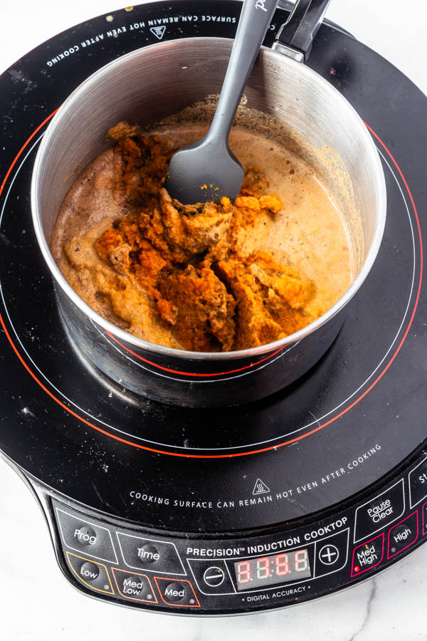 heating up milk and pumpkin puree in a small saucepan