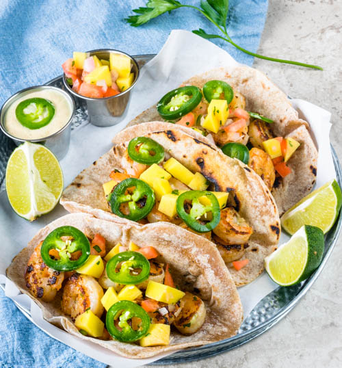 shrimp tacos with baja sauce and mango pico de Gallo