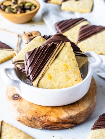Orange Pistachio Shortbread Cookies dipped in chocolate