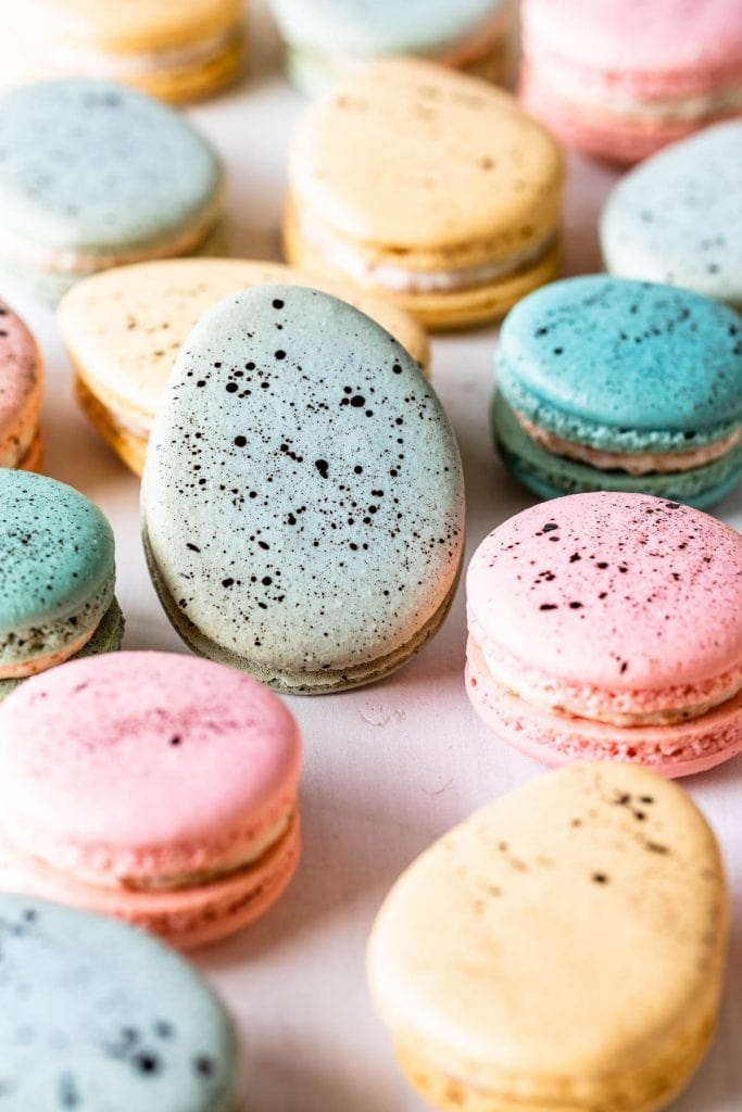 Robin's Eggs Macarons  shaped like eggs with a speckled shell.