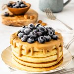 Sourdough Banana Pancakes topped with almond butter and blueberries
