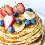 banana sourdough pancake stack with fresh fruit