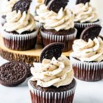 Oreo Cupcakes arranged on top of a wood board