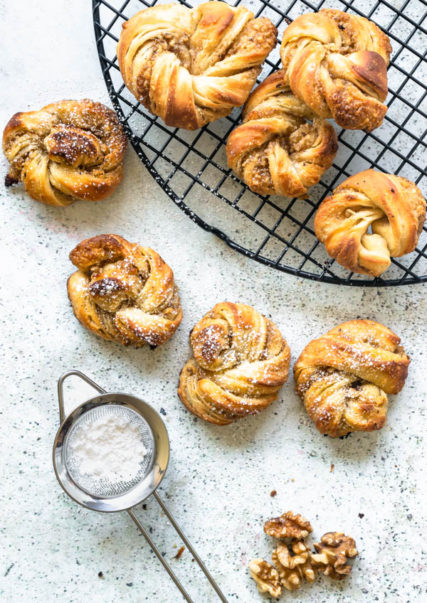 Cardamom Walnut Pastries, small pastries with a powdered sugar sifter