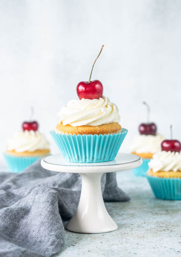 Cherry Cupcakes with cherry pastry cream filling and white chocolate cream cheese frosting