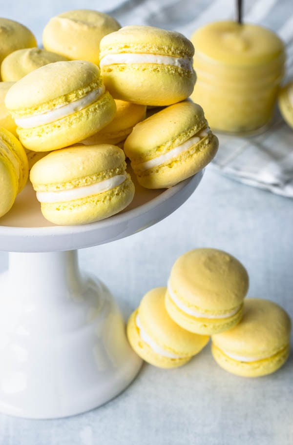 lemon macarons in a cake stand lemon curd