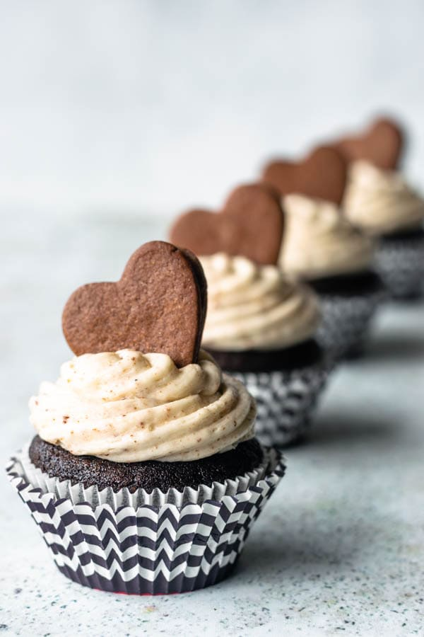 oreo cupcakes with cookies and cream frosting and homemade Oreo cookie cupcakes lined up with shadow