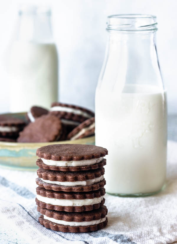 homemade oreo cookies with a glass of milk
