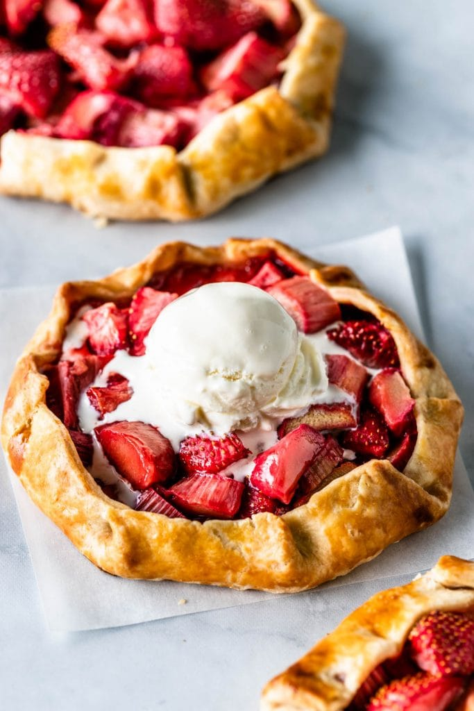 Strawberry Rhubarb Galette with ice cream on top