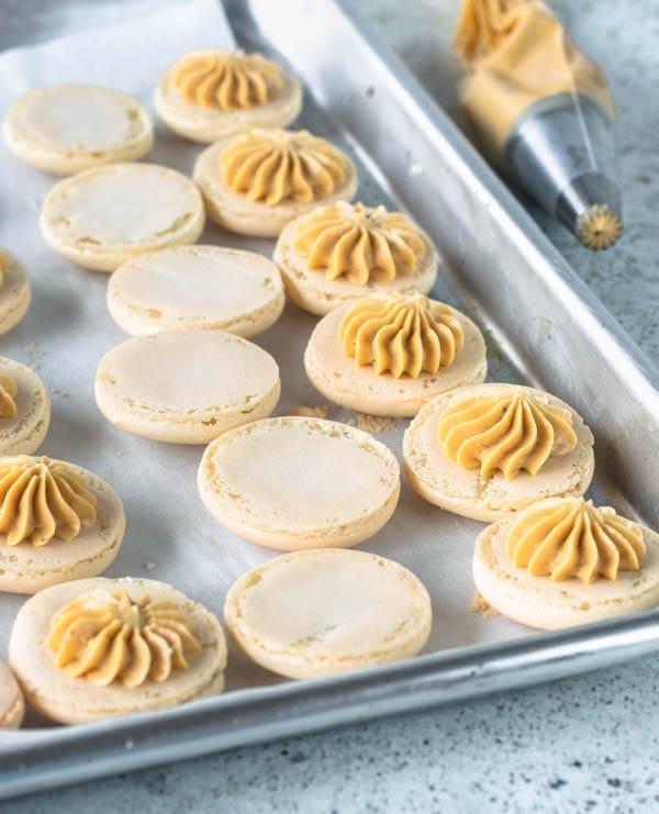 Salted Caramel Macarons piping macaron filling
