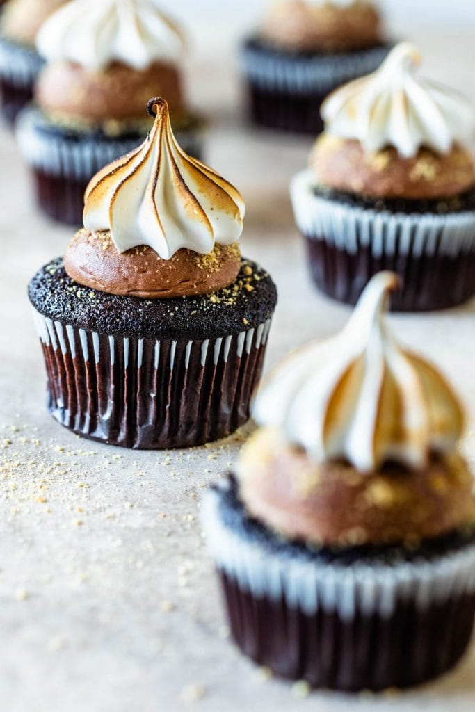 S'mores cupcakes topped with toasted marshmallow and filled with milk chocolate ganache