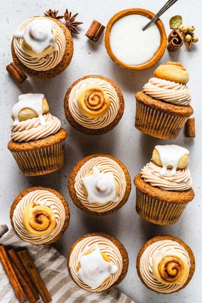 Cinnamon Roll Cupcakes topped with a glazed mini cinnamon roll seen from the top.