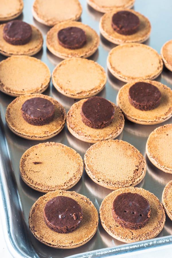 chocolate macarons with brownie circle on top