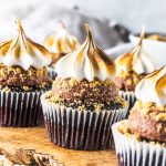 Vegan S'mores Cupcakes on a wooden board