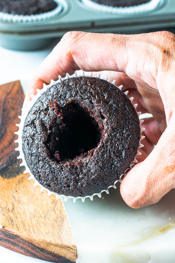 chocolate cupcake with removed center to be filled