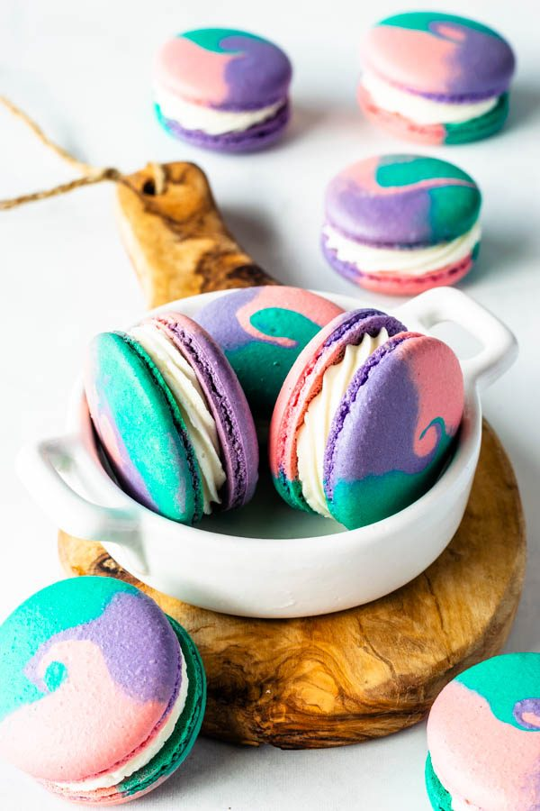 multi-color macarons in a small plate