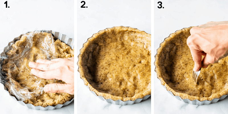 pressing pie crust on the bottom of tart pan