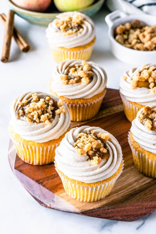 Apple Crisp Cupcakes filled with apple pie filling and topped with cinnamon cream cheese frosting and crumble topping
