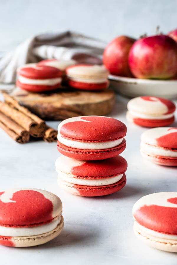 apple macarons with cinnamon cream cheese frosting and apple filling