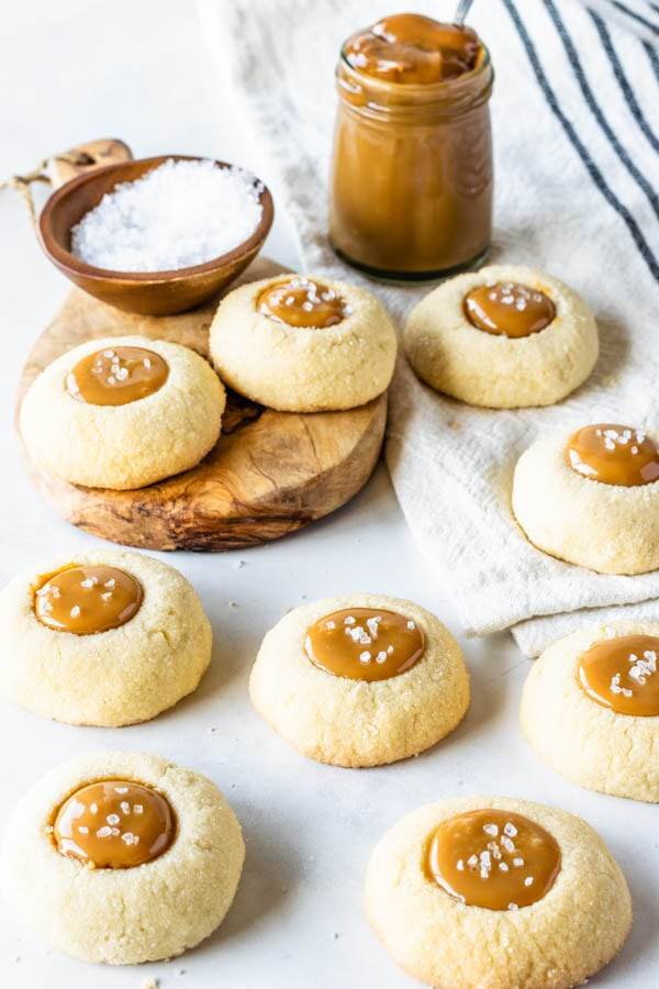 Dulce de Leche thumbprint cookies filled with dulce de leche caramel and sprinkled with sea salt