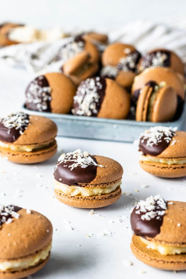 german chocolate macarons with fudge coconut filling