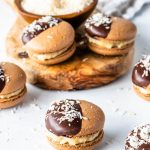 german chocolate macarons chocolate macarons filed with coconut fudge and topped with chocolate and coconut flakes