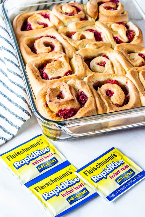 lemon raspberry rolls with lemon glaze filled with raspberries