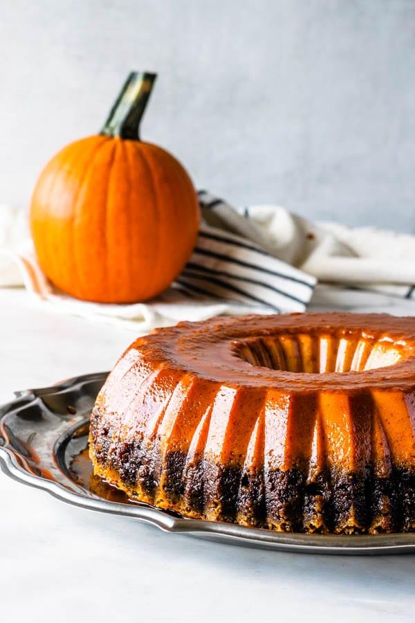 pumpkin flan with chocolate cake on the bottom and flan on top