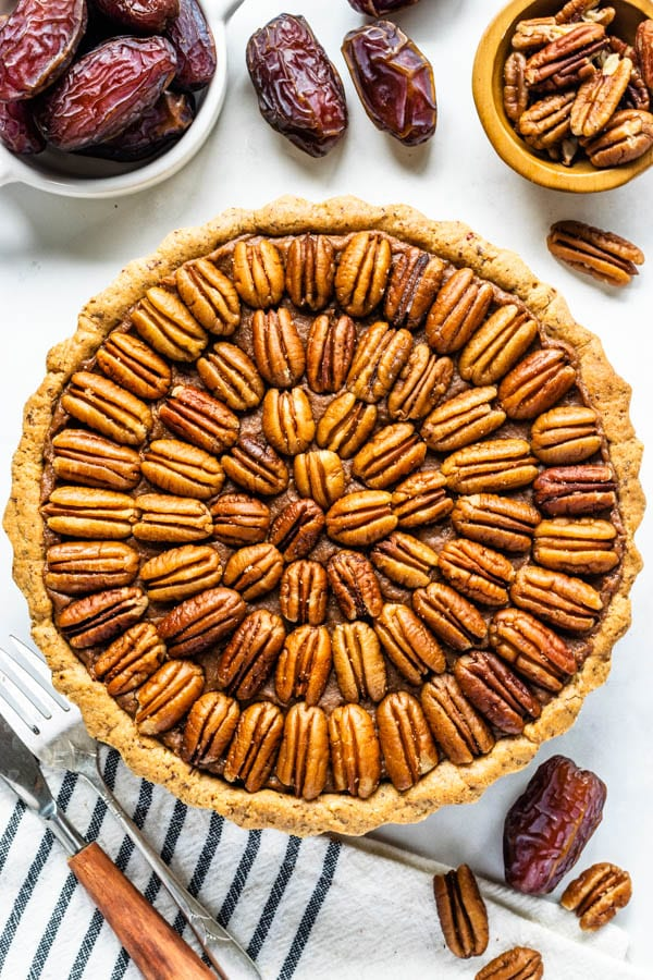 Vegan Pecan Pie also paleo, refined sugar free, covered with pecans, made with dates