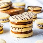 Alfajor Recipe filled with dulce de leche drizzled with melted chocolate