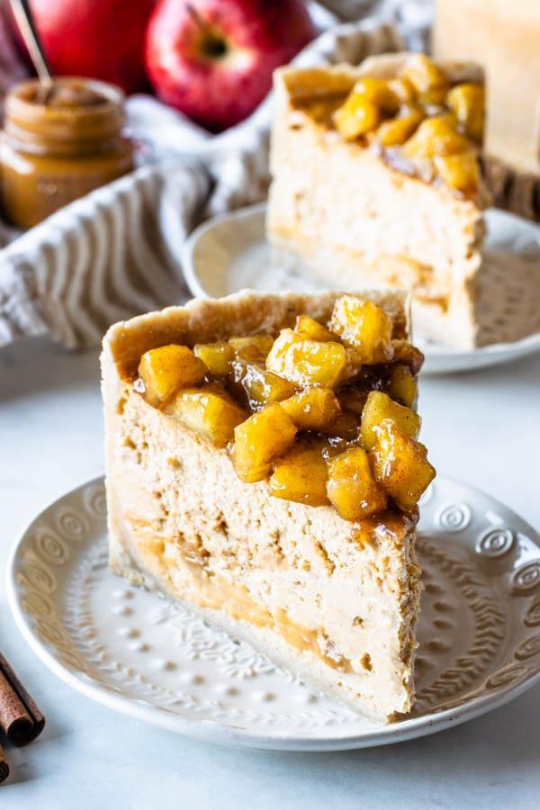 slice of apple dulce de leche cheesecake