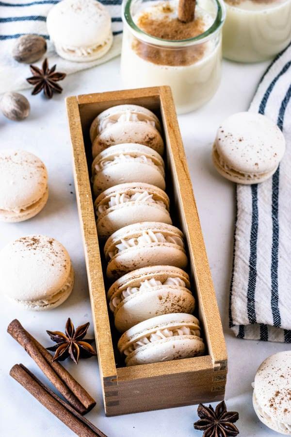 Eggnog Macarons dusted with cinnamon