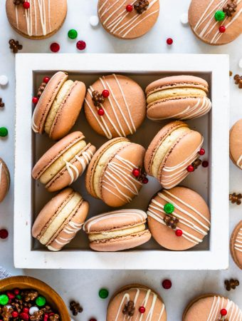 Gingerbread Macarons filled with gingerbread buttercream topped with christmas sprinkles