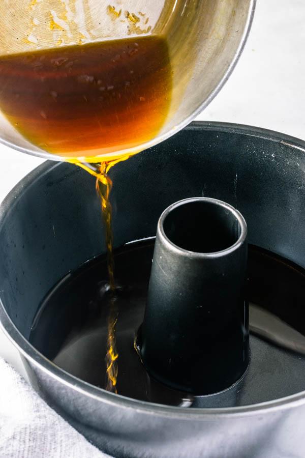 pouring caramel in bundt pan