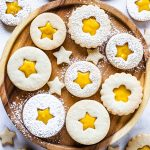 Passion Fruit Cookies filled with passion fruit curd, dusted with powdered sugar