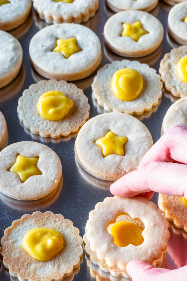 making passion fruit linzer cookies