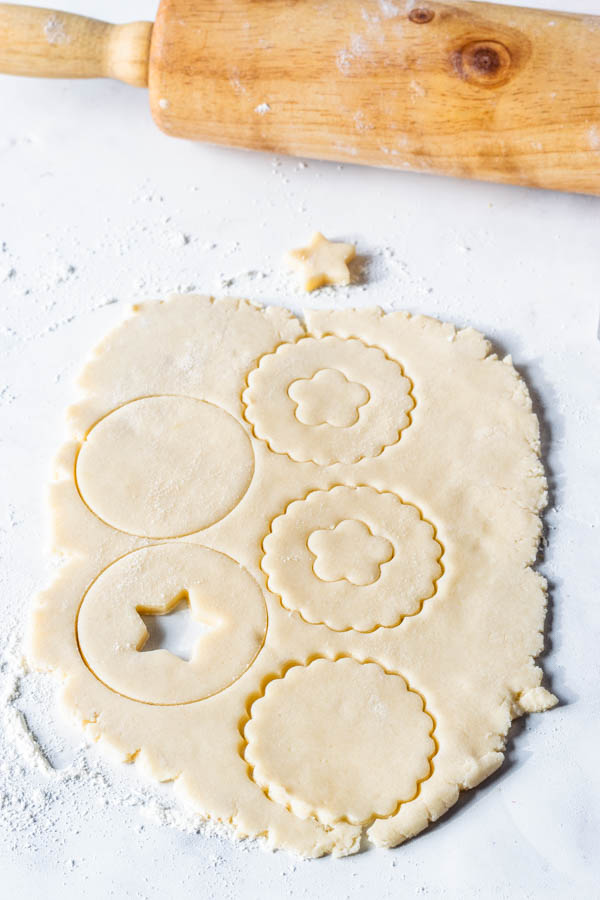 linzer cookies being cut