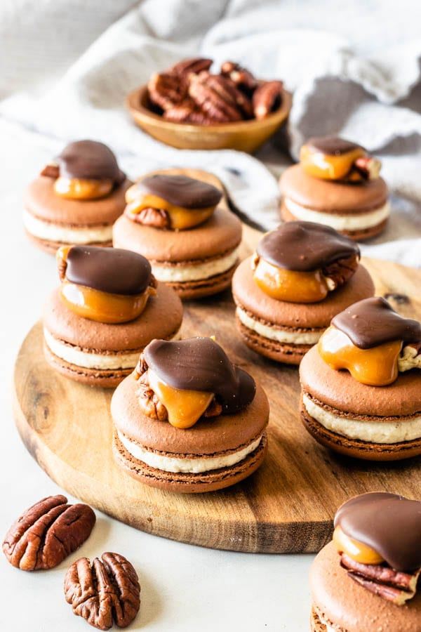 Pecan Turtle Macarons topped with a pecan turtle candy