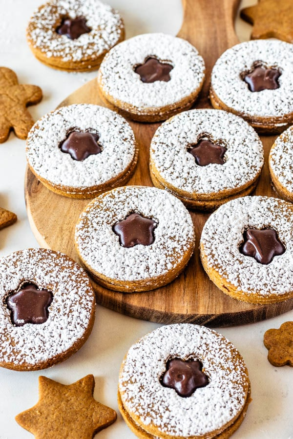Vegan Gingerbread Cookies with Fudge Filling dusted with powdered sugar