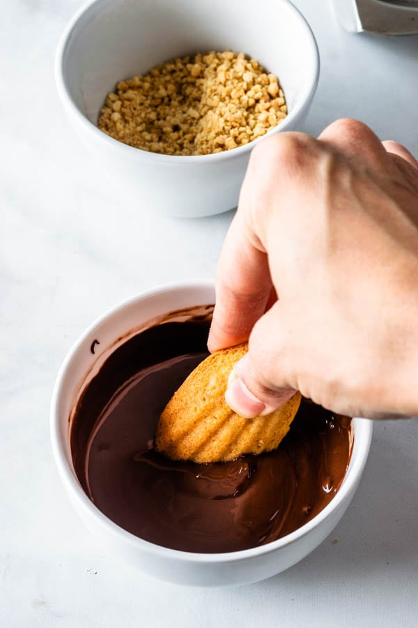 dipping madeleines in chocolate