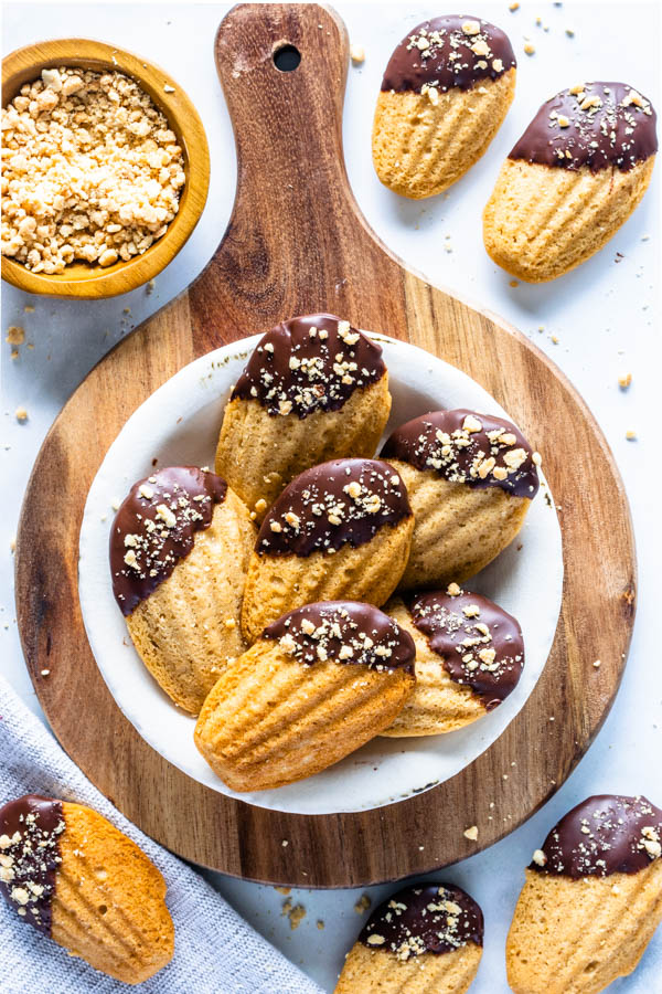 Vegan Peanut Butter Madeleines dipped in chocolate and topped with peanuts