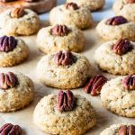 Vegan Pecan Cookies with a touch of bourbon topped with a pecan