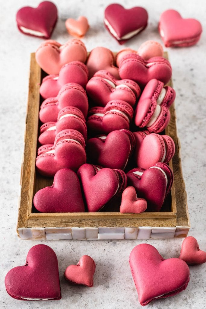 burgundy and pink Heart Macarons in a box.