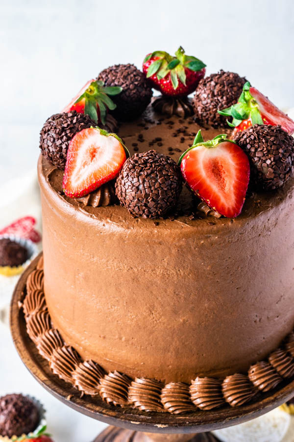 Strawberry Nutella Cake topped with truffles and strawberries