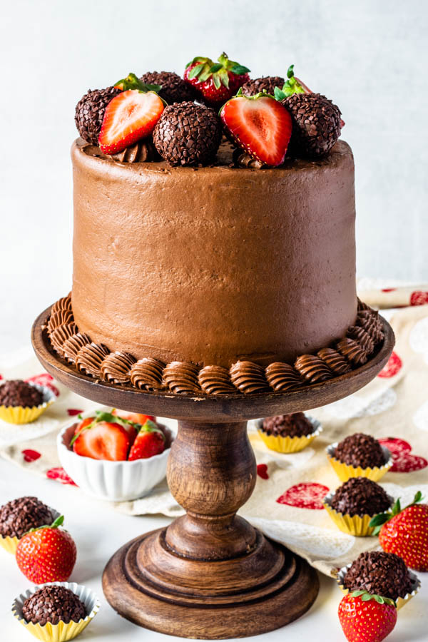 Strawberry Nutella Cake topped with nutella fudge balls and fresh strawberries