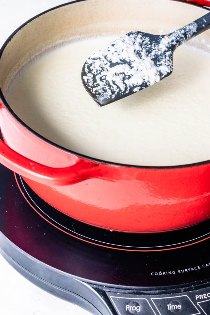 curdling milk and heavy cream to make ricotta