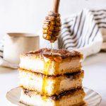 Sopapilla Cheesecake Bars with honey drizzle