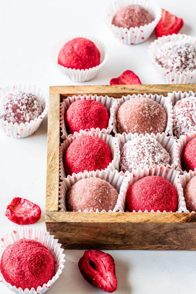 White Chocolate Strawberry truffles coated in coconut, freeze dried strawberry powder, and sugar