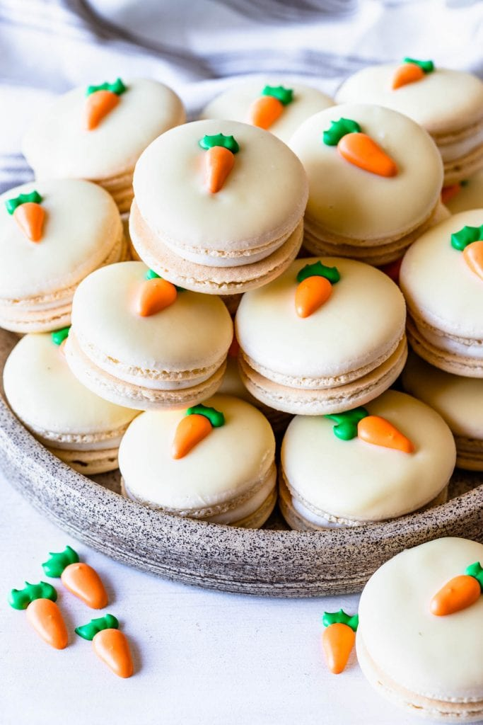 Carrot Cake Easter Macarons topped with a royal icing carrot