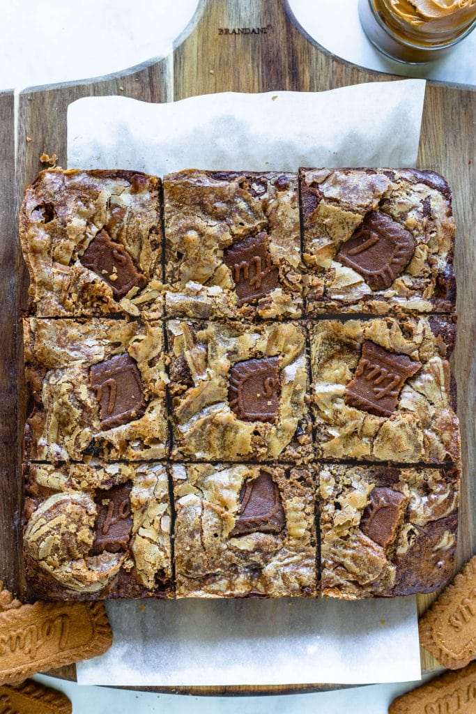 bird's eye view of cookie butter brownies, topped with a biscoff swirl and biscoff cookies